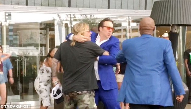 Nicolas Cage Physically Restrains Rocker Vince Neil After He Throws Woman To The Ground